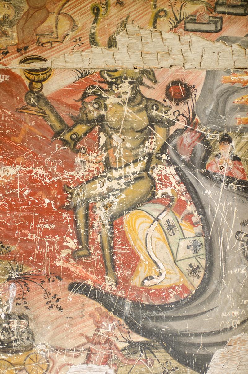 Beelzebub, la intrarea în Iad (simbolizată printr-o gură de balenă), ținând în mână cupa suferinței